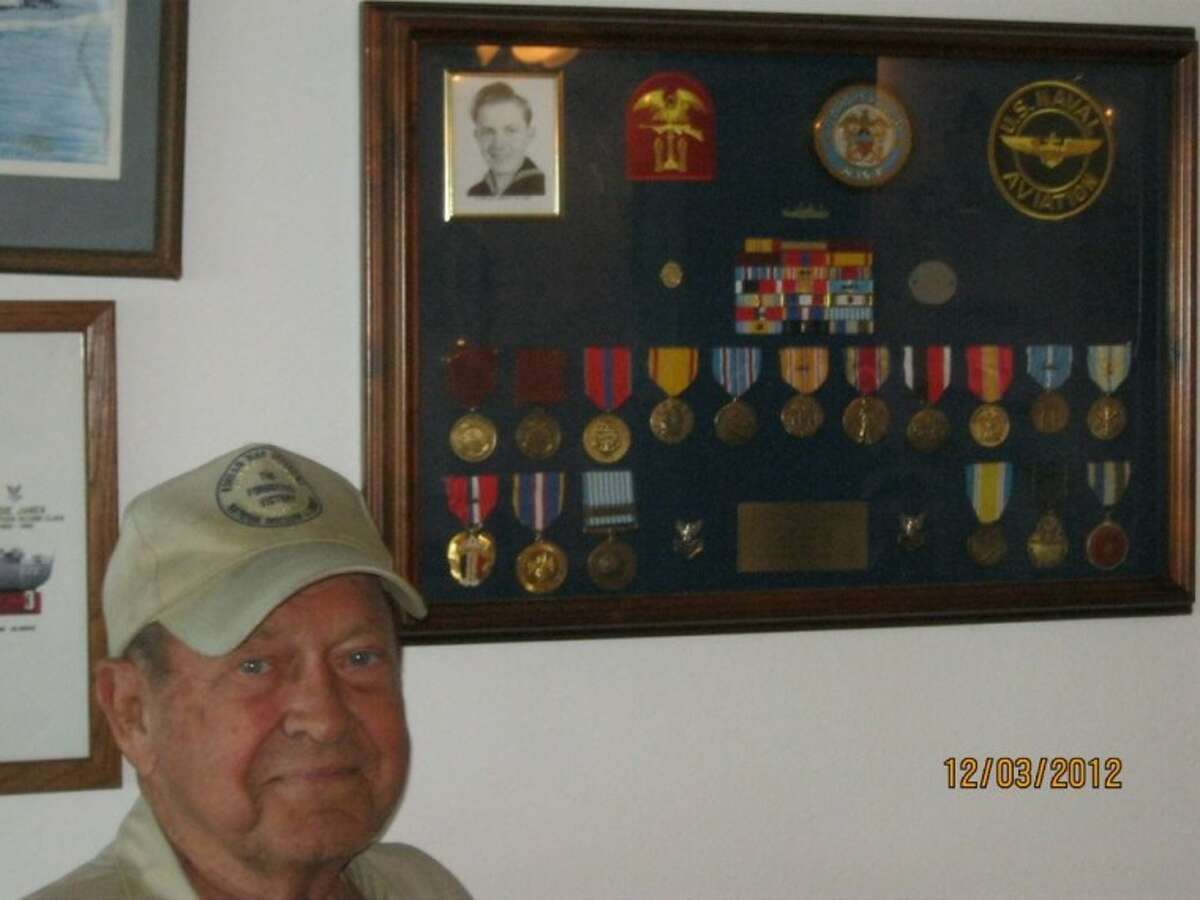 Eddie Janek proudly displays his medals from serving in the Navy. They were temporarily lost in the aftermath of Hurricane Ike in 2008.