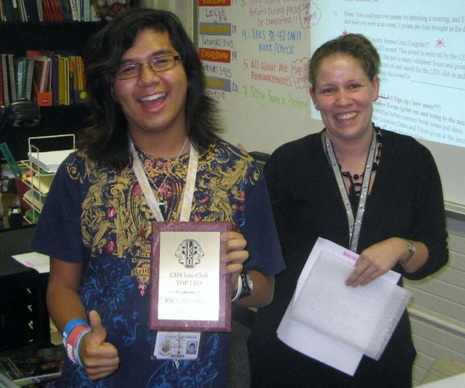 CHS Leo Club member Joey Mendoza, left, is all smiles as he accepts the Top Leo Award from CHS Leo Club Advisor and Conroe Noon Lions Club member Emily Hamilton. Photo: Courtesy Photo
