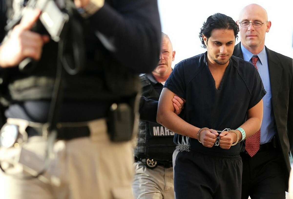 In this Feb. 25, 2011, file photo, Khalid Ali-M Aldawsari is escorted to court in Lubbock, Texas. A jury was selected last Thursday for the trial of the Saudi man who is accused of gathering bomb components with the intention of targeting sites across the United States, including the home of former President George W. Bush.