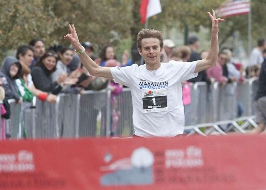 Jeffrey Eggleston, of Flagstaff, Ariz., finishes first in The Woodlands Marathon on Saturday. Photo: Karl Anderson