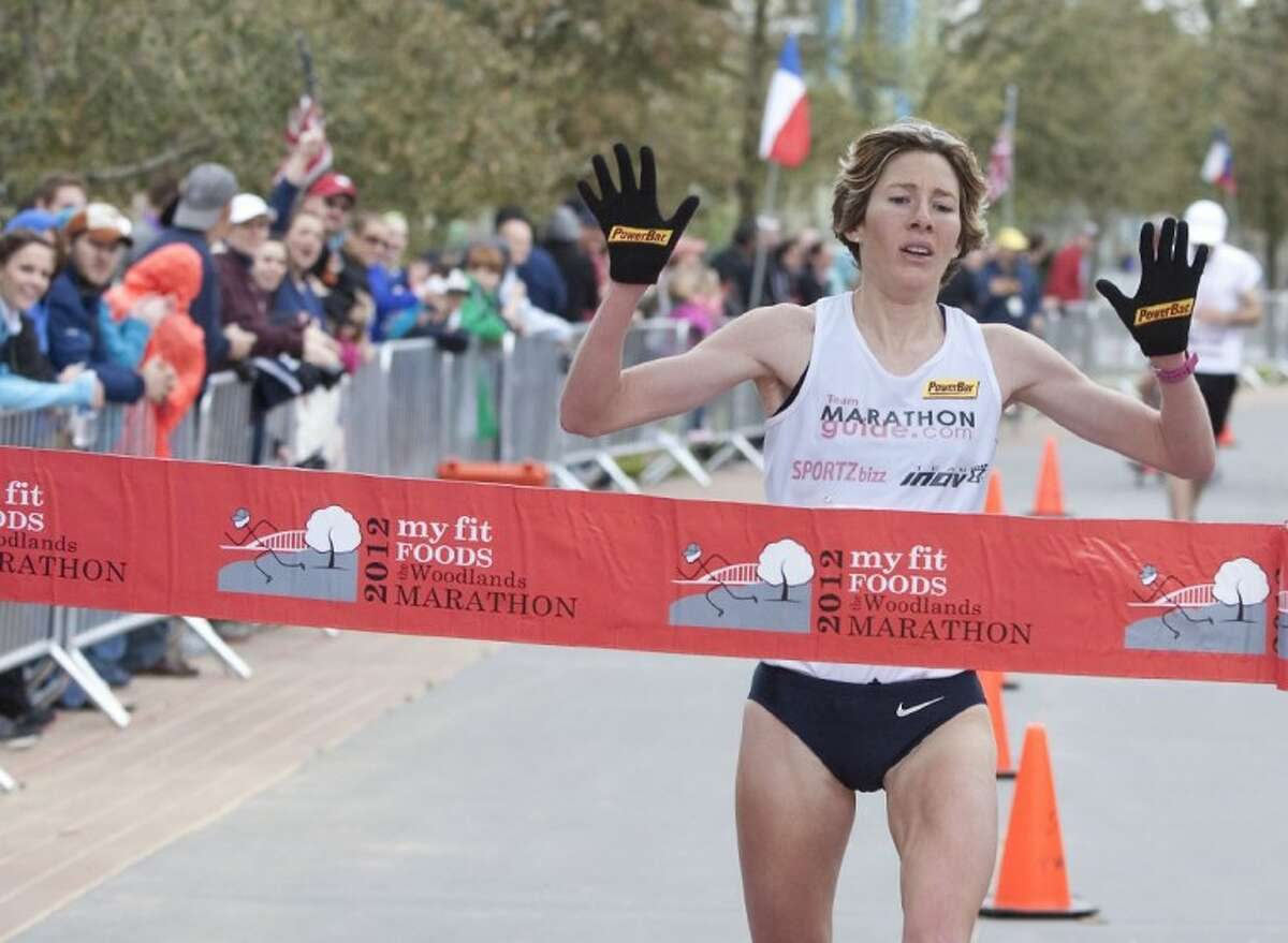 Camille Herron, of Warr Acres, Okla., finishes first in the Woodlands Marathon on Saturday.