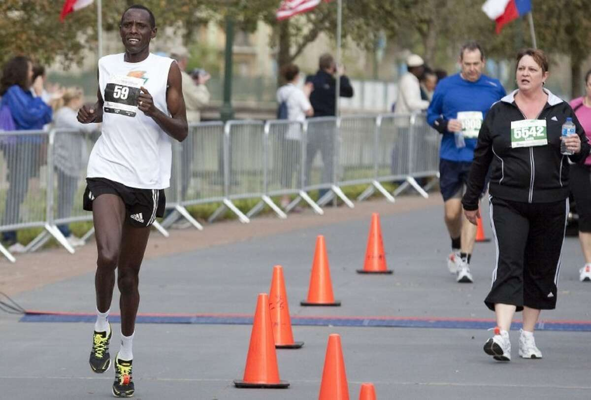 finishes first in the Woodlands Half Marathon on Saturday.