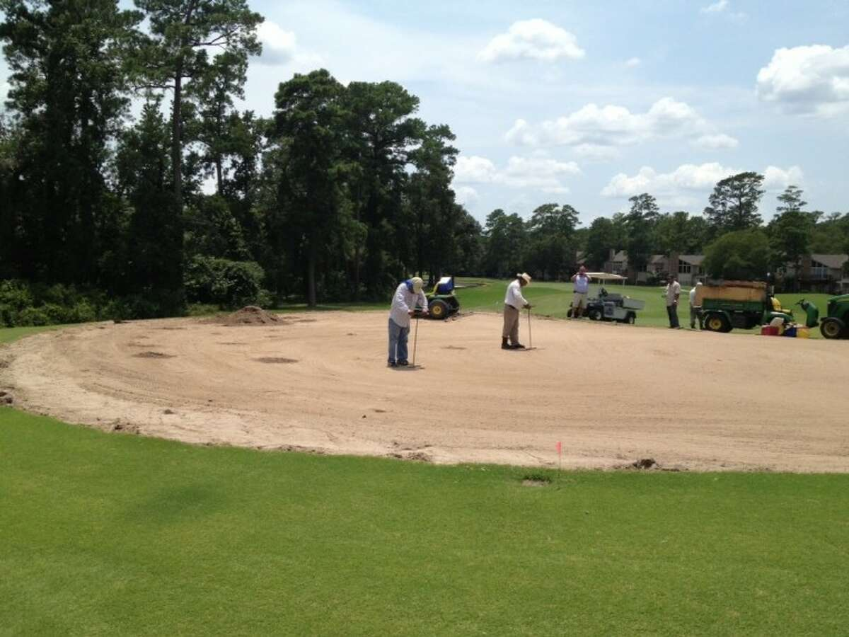 Construction workers prepare an area for turf during the recent renovations at The Woodland Country Club golf course.