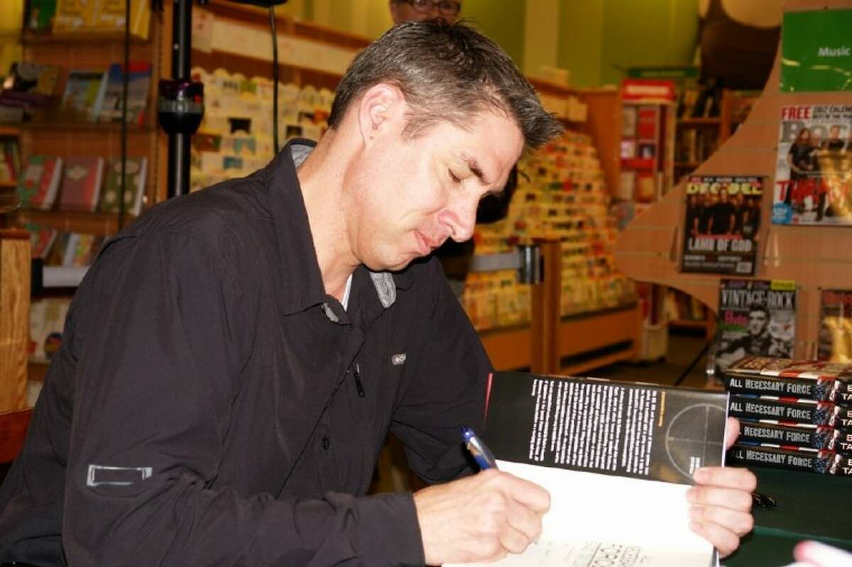 Brad Taylor, best-selling author and graduate of Conroe High School, spoke to fans and signed books Sunday at Hastings in Conroe. His second novel,