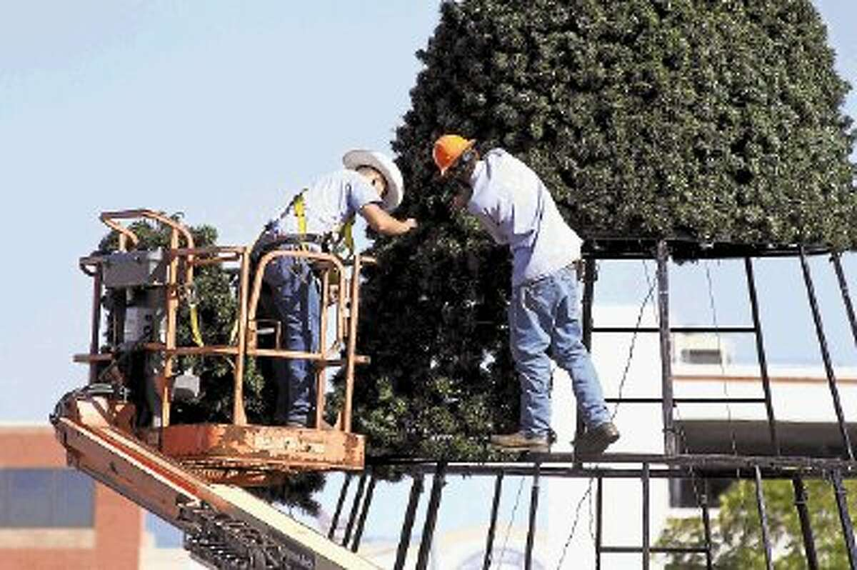 City of Conroe works put together Conroe's Christmas tree at the corner of Texas 105 and Frazier Street. The tree will be lit on Nov. 26 at 6:30 p.m.