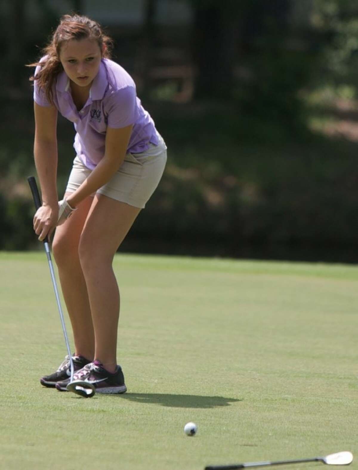 Willis' Carrina Blakeney eyes her putt on the 18th hole during the final round of play Wednesday at the District 18-4A tournament at The Village Golf Club in Panorama Village.