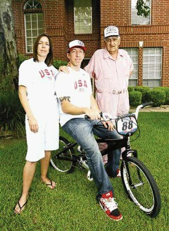 In this 2008 file photo, Kyle Bennett poses outside his Conroe home with his mother Donnel Purse and his grandfather Don Collins. Purse and Collins provided the support Bennett needed to develop into a world champion BMX racing. Photo: Karl Anderson