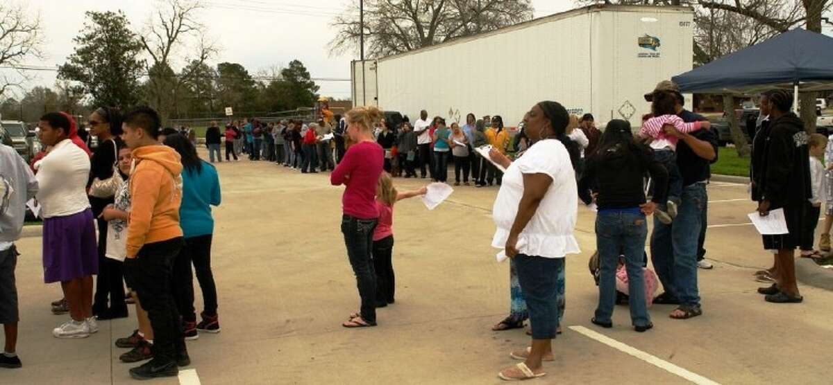 The line for the One Gen Away food drive stretched around Berton A. Yates football stadium in Willis Saturday.