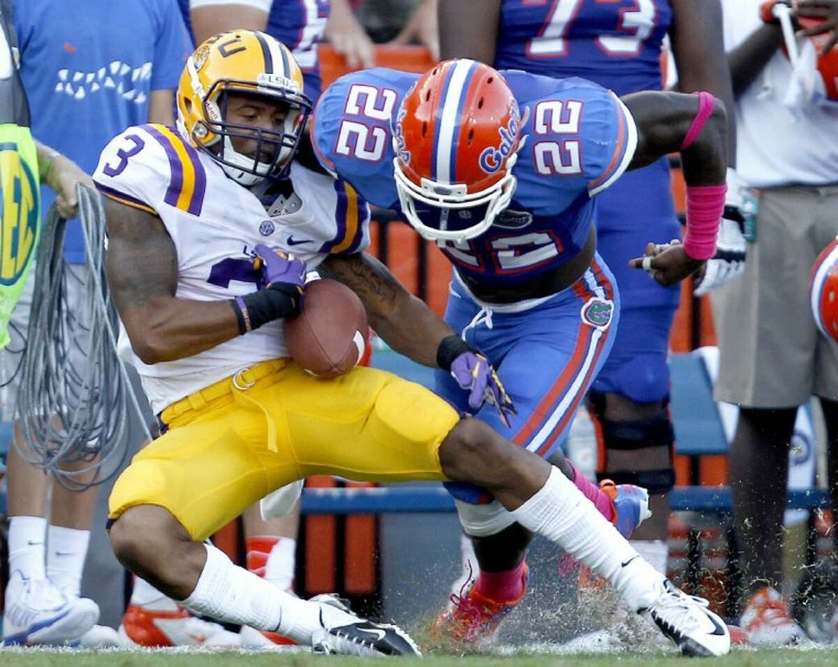 Florida safety Matt Elam, right, forces LSU wide receiver Odell Beckham Jr. to fumble the ball after a long reception. Florida won 14-6.