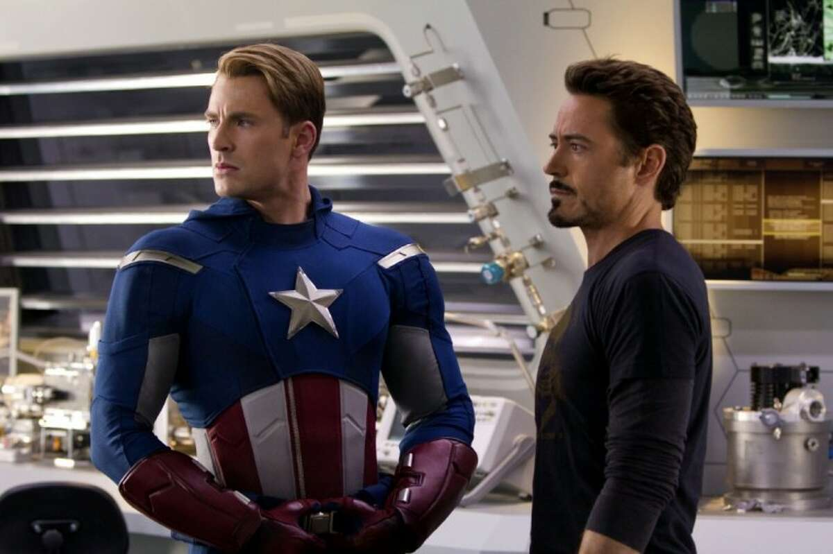 """In this photo provided by Disney, Chris Evans, portraying Captain America, left, and Robert Downey Jr., portraying Tony Stark, act in a scene from """"Marvel's The Avengers."""""""
