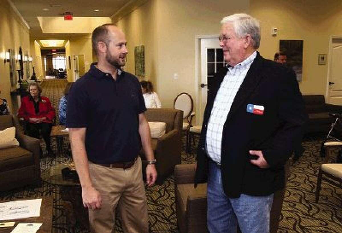 Live Oak Assisted Living executive director Alex Primeau, left, talks with Montgomery Mayor John Fox during dedication ceremonies Friday.