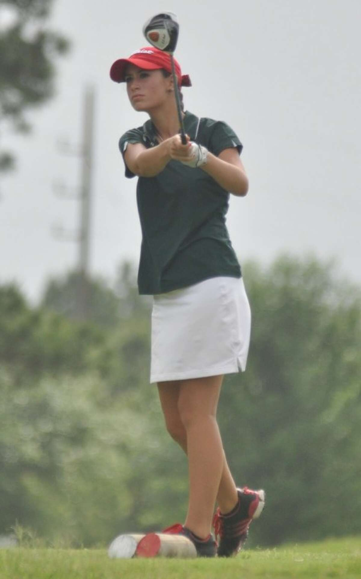 The Woodlands' Cheyenne Knight hits a tee shot during the District 14-5A girls golf tournament at Oakhurst Golf Club in Kingwood on Tuesday.