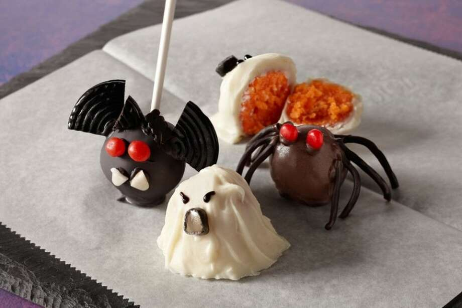 These creative Creepy Crawly Cake Truffles hold a surprise inside - an orange cake center. Photo: Michael Pohuski