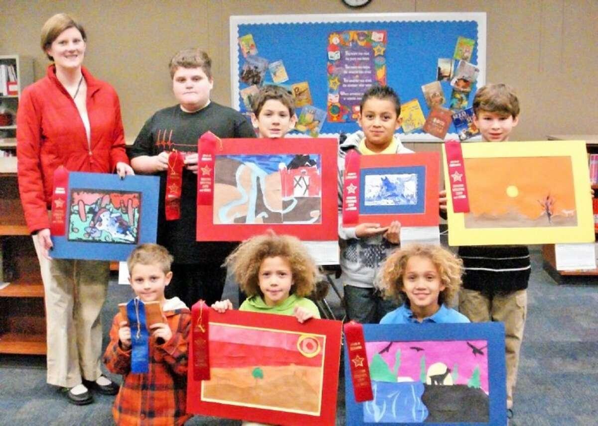 Glen Loch Elementary Rodeo Art Show participants proudly display their winning art work.