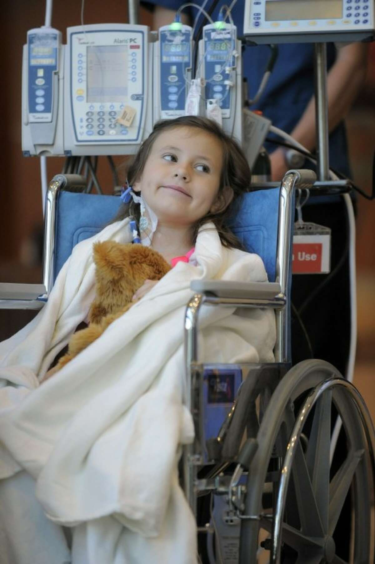 Seven-year-old Sierra Jane Downing from Pagosa Springs, Colo., smiles during a news conference about her recovery from bubonic plague at the Rocky Mountain Hospital for Children at Presbyterian/St. Luke's Wednesday in Denver. It is believed Downing caught the bubonic plague from burying a dead squirrel.