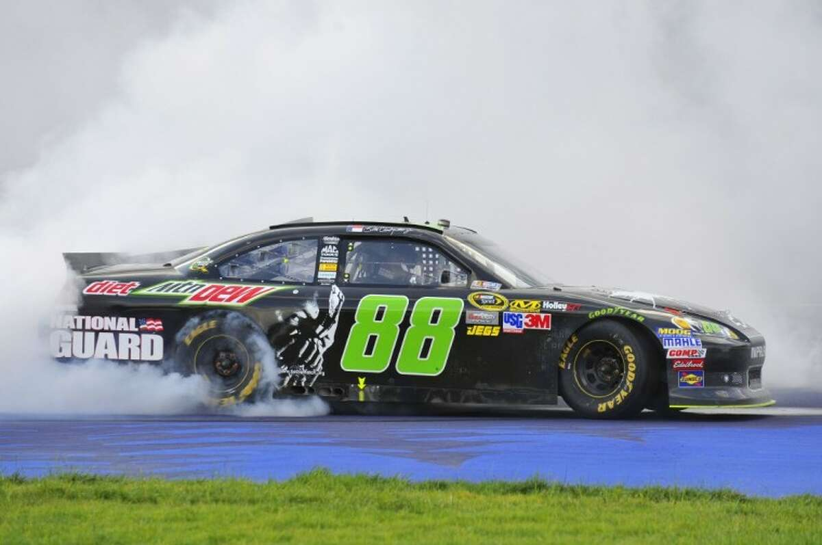 Dale Earnhardt Jr. celebrates his win with a burnout after the NASCAR Sprint Cup Series Quicken Loans 400 auto race at Michigan International Speedway, Sunday in Brooklyn, Mich.