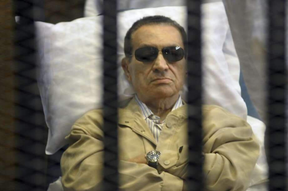 In this June 2 photo, Egypt's ex-President Hosni Mubarak lays on a gurney inside a barred cage in the police academy courthouse in Cairo, Egypt. Photo: STR
