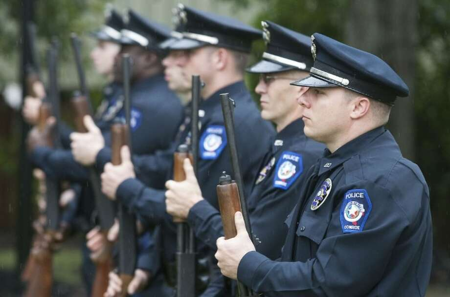 Conroe police officers perform a 21- gun salute during the Conroe Police Department's annual ceremony for Peace Officers Memorial Day Tuesday at Heritage Place Park in Conroe. Photo: Karl Anderson