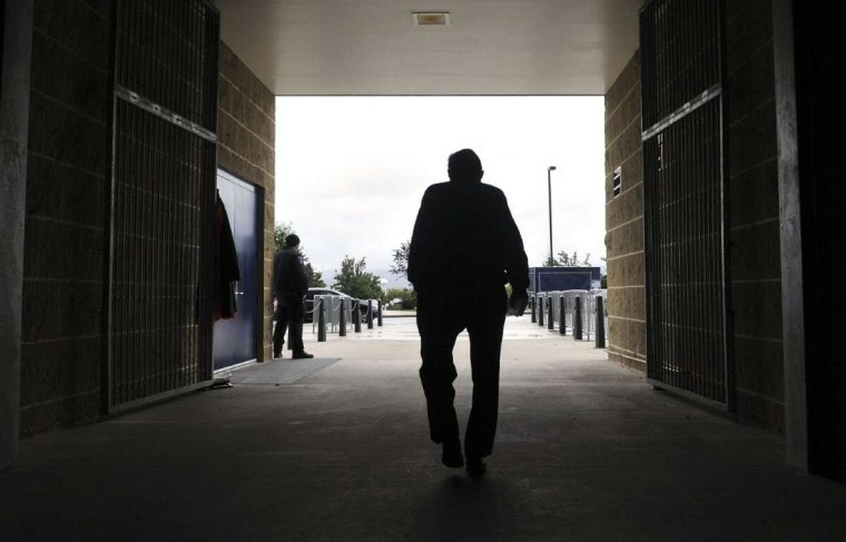 FILE - In this Oct. 5, 2010 file photo, Penn State football coach Joe Paterno leaves Beaver Stadium after his weekly news conference on Tuesday, Oct. 5, 2010 in State College, Pa. Paterno,