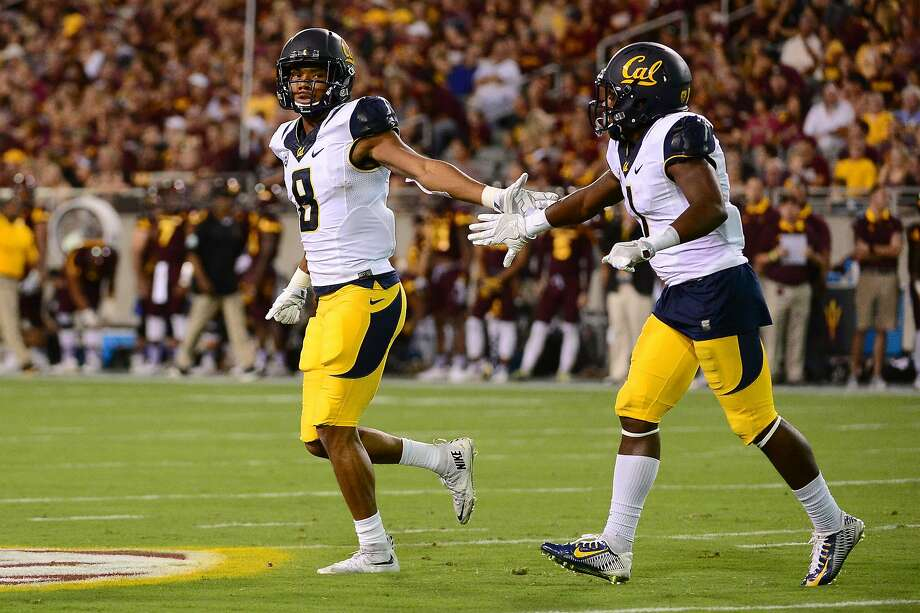 TEMPE, AZ - SEPTEMBER 24:  Wide receiver Demetris Robertson #8 of the California Golden Bears is congratulated by teammate wide receiver Melquise Stovall #1 after scoring a 19 yard touchdown in the first half against the Arizona State Sun Devils at Sun Devil Stadium on September 24, 2016 in Tempe, Arizona.  (Photo by Jennifer Stewart/Getty Images) Photo: Jennifer Stewart, Getty Images