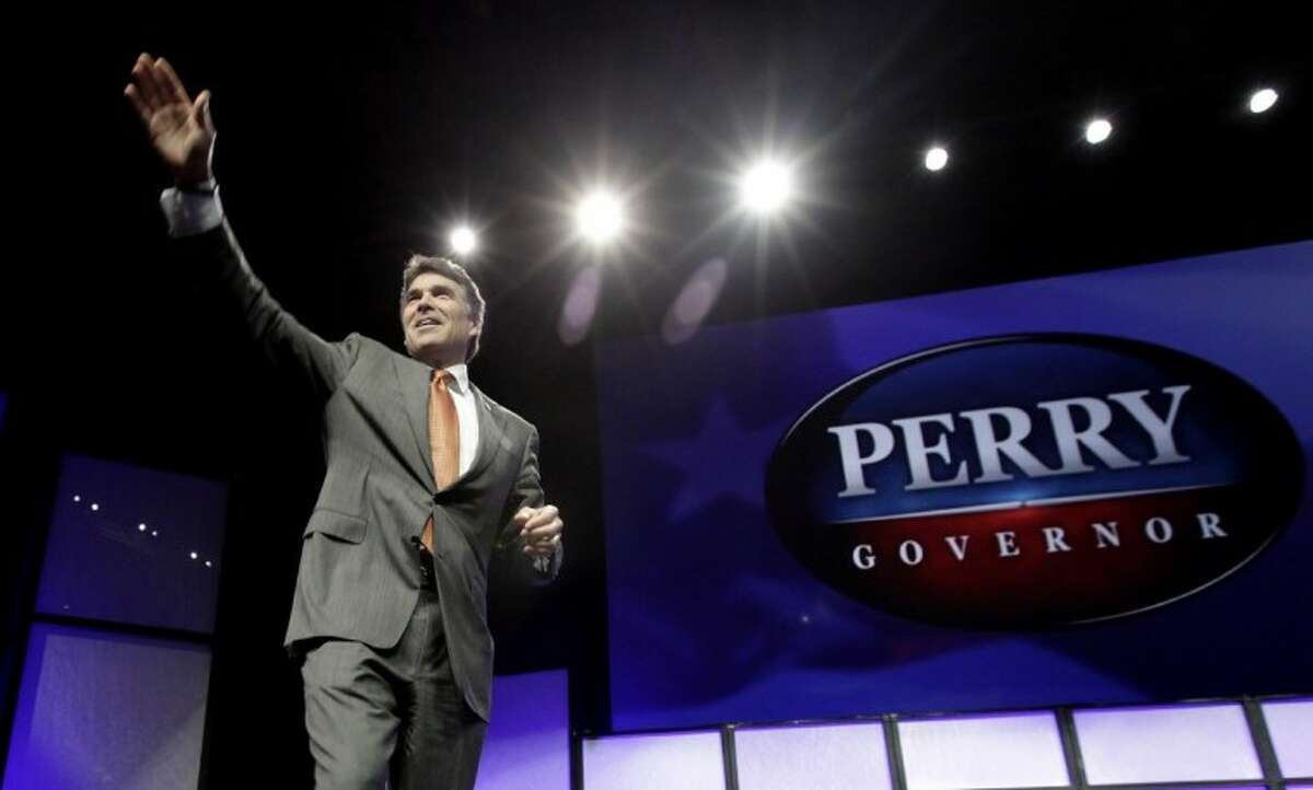 Texas Gov. Rick Perry waves after speaking during the Texas Republican Convention in Fort Worth Thursday.