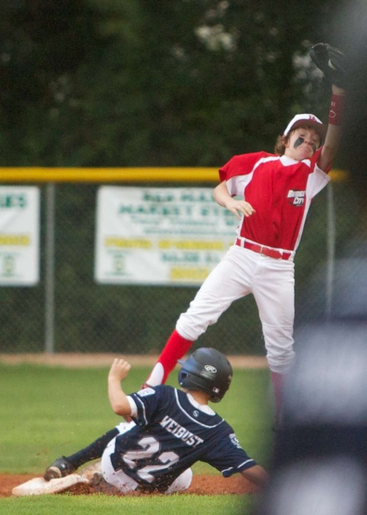 ORWALL National's Tyler Weibust slides safely into second base during Wednesday night's Texas East Little League Section 2 tournament game against Bridge City at the ORWALL Complex in Spring.
