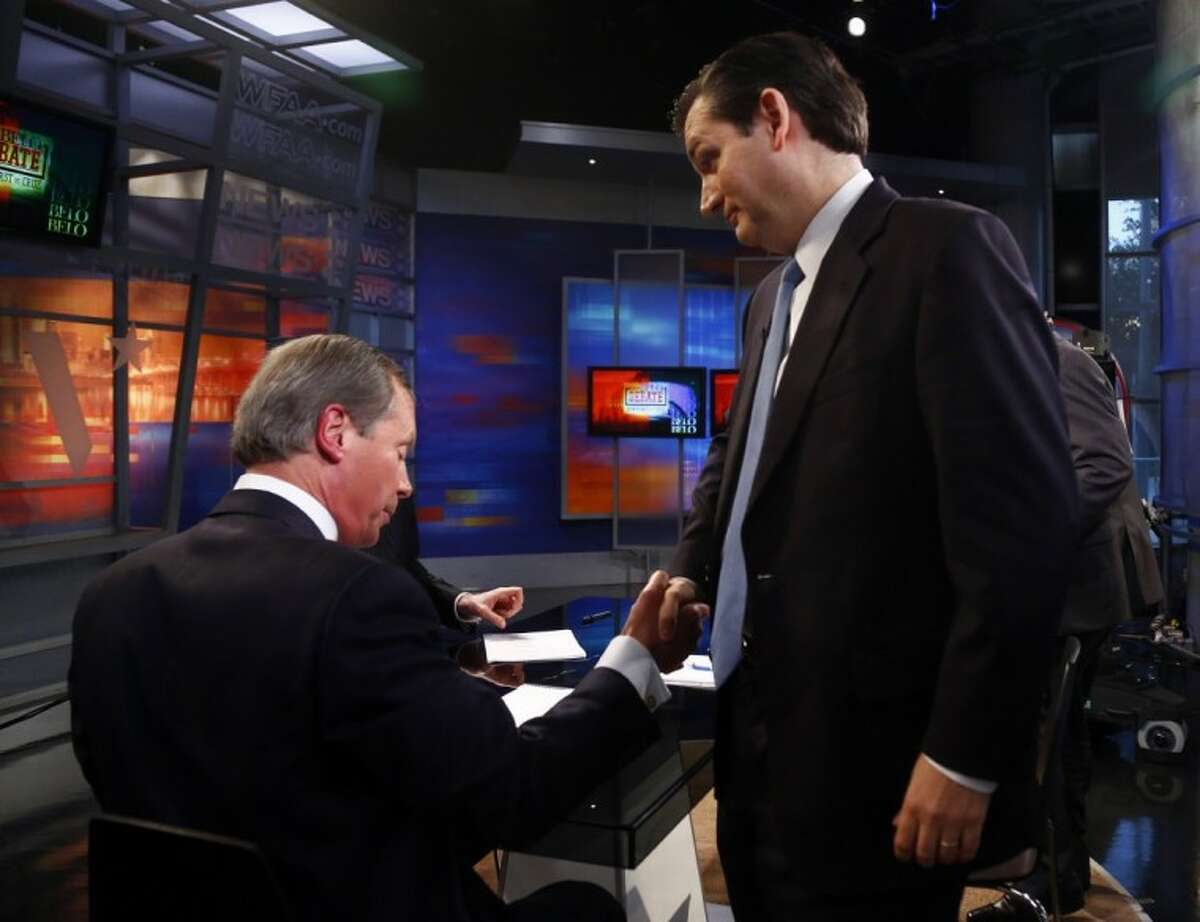 U.S. Senate Republican candidates David Dewhurst, left, and Ted Cruz, shake hands following their debate at WFAA Victory Plaza studio July 17 in Dallas.