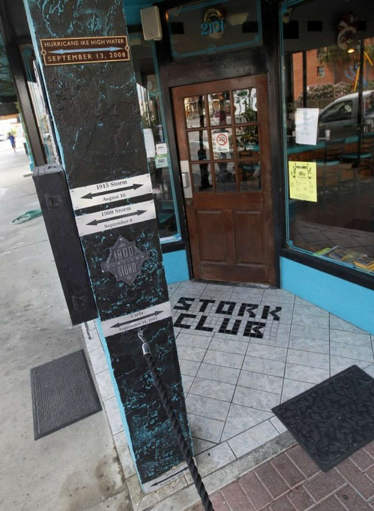 A high water marker for Hurricane Ike on the post outside the Stork Club, 2101 Post Office St. in Galveston, tops the markers for the island's other big storms, including the 1900 Storm and Hurricanes Carla and Alicia.