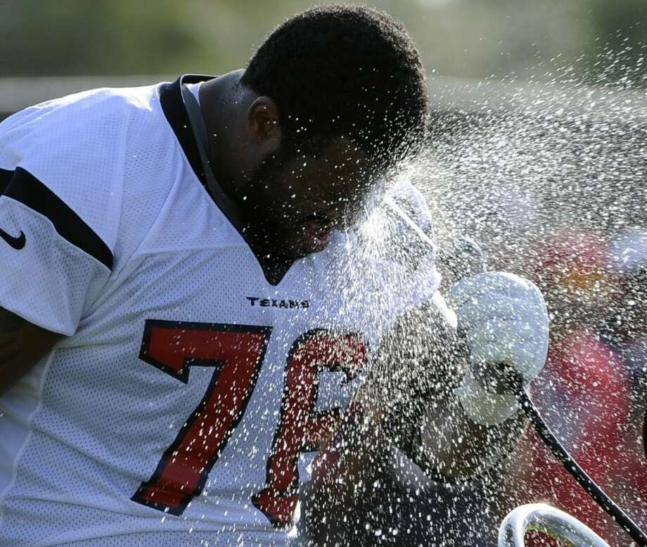 The Houston Texans' Duane Brown cools off during training camp on July 29 in Houston. Photo: Pat Sullivan