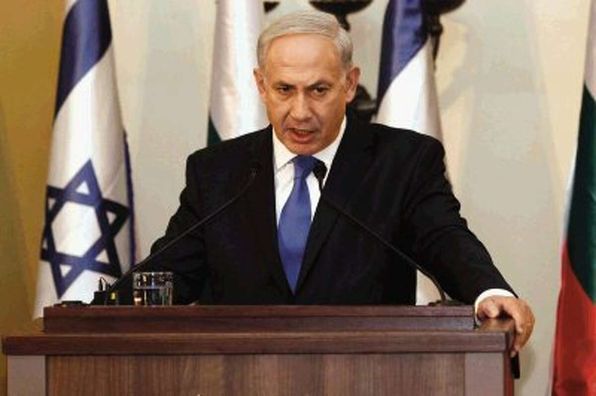 """In this Sept. 11, 2012, photo, Israeli Prime Minister Benjamin Netanyahu speaks during a joint press conference. Netanyahu is making a direct appeal to U.S. voters to elect a president willing to draw a """"red line"""" with Iran. Netanyahu on Sunday, Sept. 16, 2012, used this week's focus on unrest across the Muslim world to warn Americans watching two Sunday talk shows that time is running out to confront Tehran on its nuclear program. It was an impassioned election-season plea for a world leader who insists he doesn't want to insert himself into U.S. politics."""