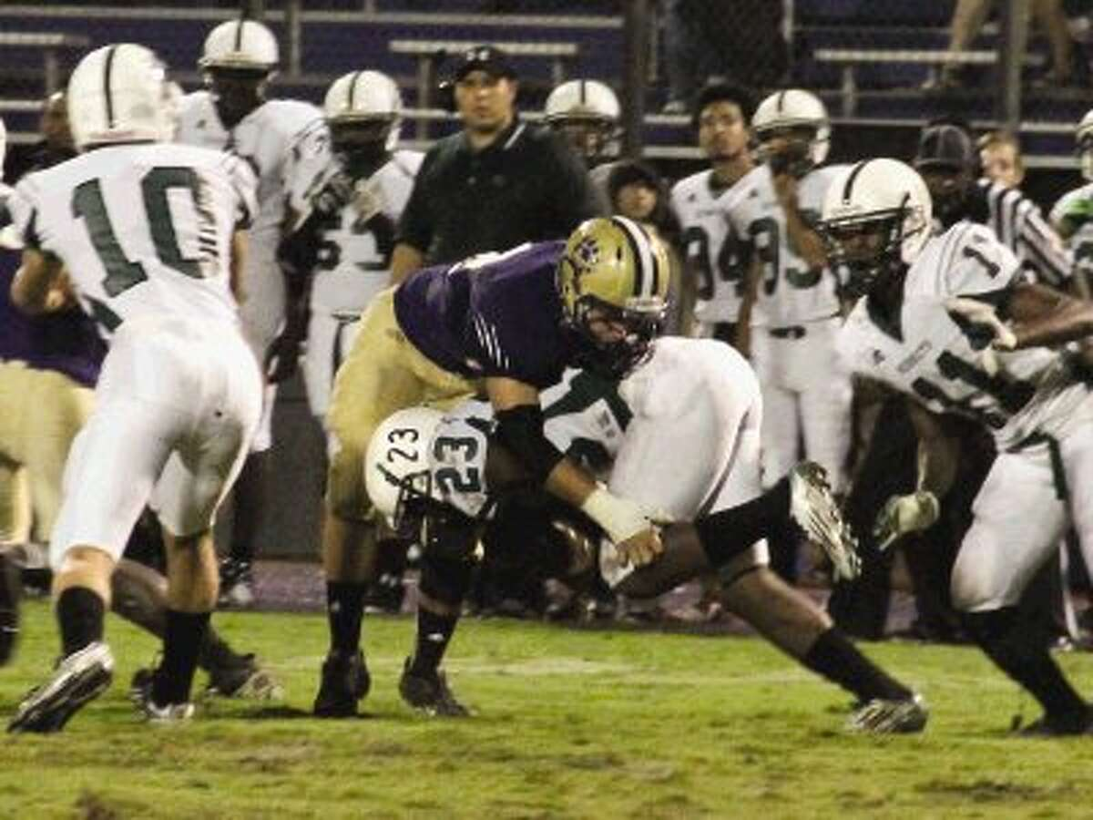 Montgomery safety Makenzie Liston takes down Hornets running back Darvin Glass during Friday night's game at Bear Staidum.