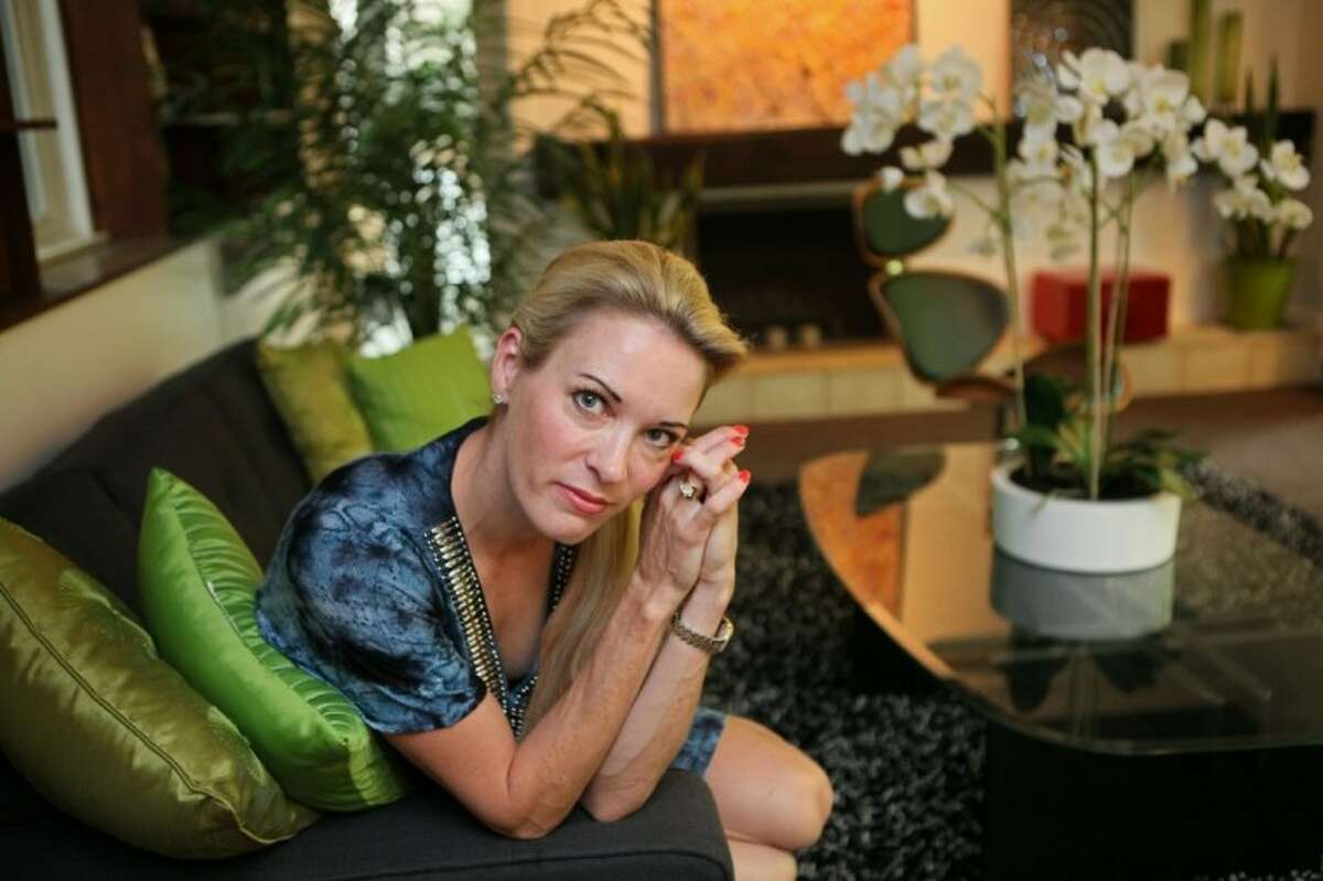 Suzy Favor Hamilton poses for a portrait on July 17 at her home in Shorewood Hills, a suburb of Madison, Wis. The three-time Olympian has admitted leading a double life as an escort. She apologized Thursday after a report by The Smoking Gun website said she had been working as a prostitute in Las Vegas.