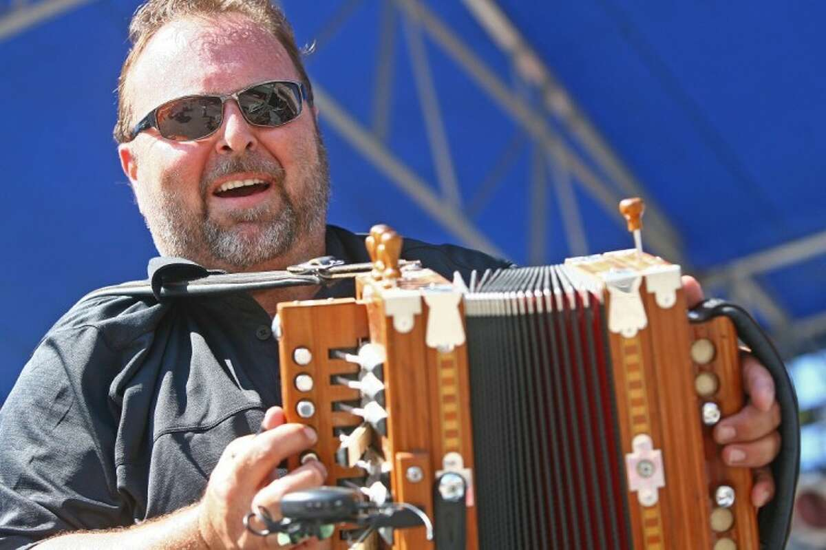Lee Johnson of Lee Johnson and the Texas Squeeze Band plays an accordion during the 2011 Conroe Cajun Catfish Festival in downtown Conroe.