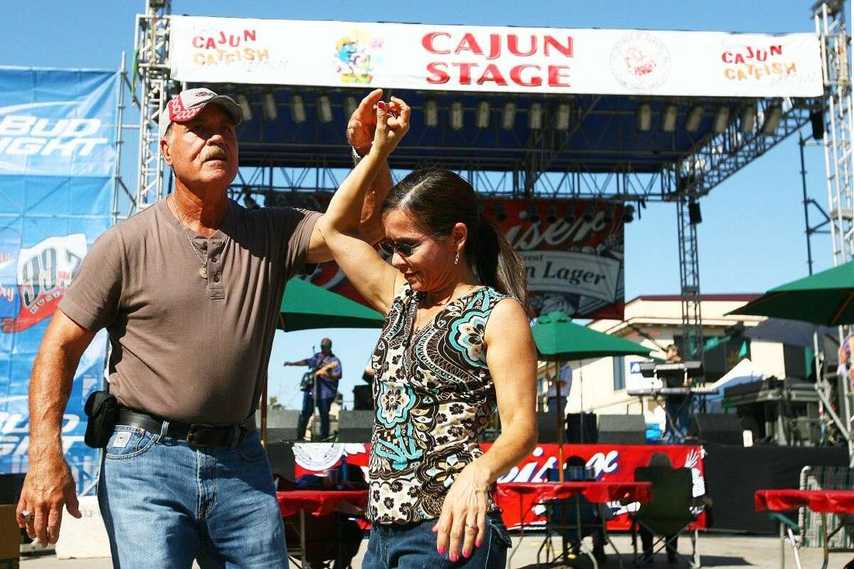 Joe and Gail Harris of Pasadena dance to Lee Johnson and the Texas Squeeze Band in front of the Cajun Stage during a previous Conroe Cajun Catfish Festival in downtown Conroe.
