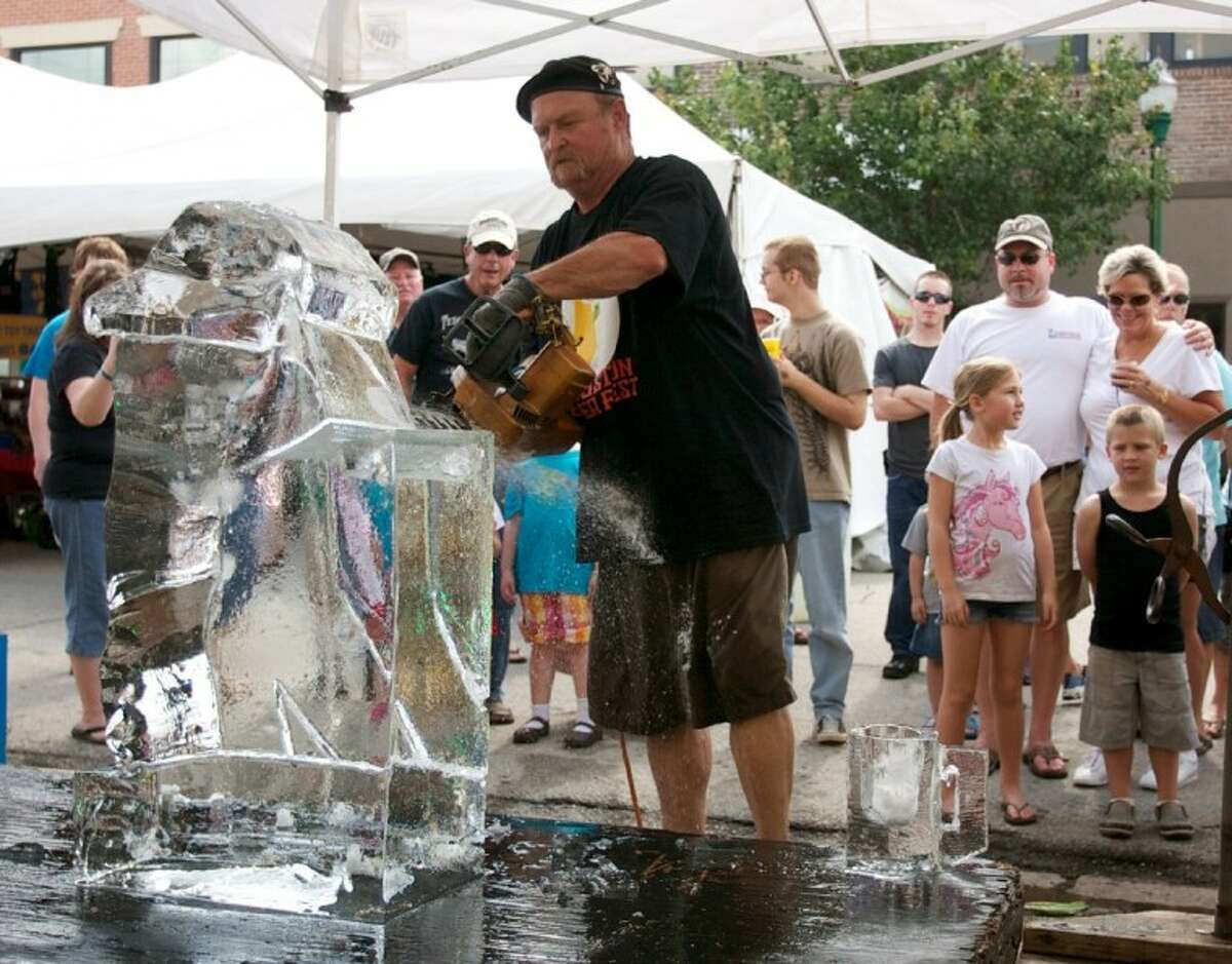 Ice sculptor Jay Maclaskey carves out a sculpture in front of attendees during Saturday's Conroe Cajun Catfish Festival in downtown Conroe.
