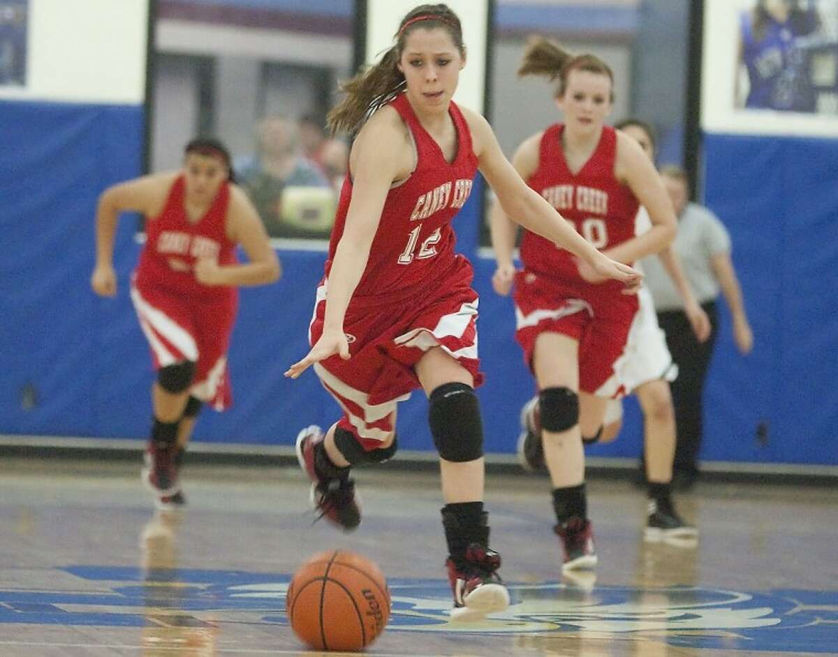 Caney Creek's Kayla Sprowl breaks free with the ball during the game against New Caney Friday at New Caney High School. See more photos online at www.yourconroenews.com/photos.