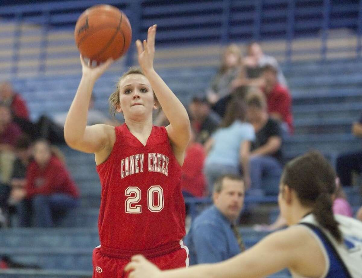 Caney Creek's Jessica Twardowski shoots a basket during the game against New Caney Friday at New Caney High School. See more photos online at www.yourconroenews.com/photos.