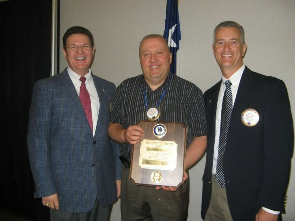 """The Conroe Noon Lions Club honored Lion Wayne Mack, center, with the prestigious Jack Weich Award from the Texas Lions Camp in Kerrville for his dedication and support of the camp and it's """"can do"""" motto. Making the presentation was Past District Governor Glen Starr, left, and Club President Rich Sproba."""