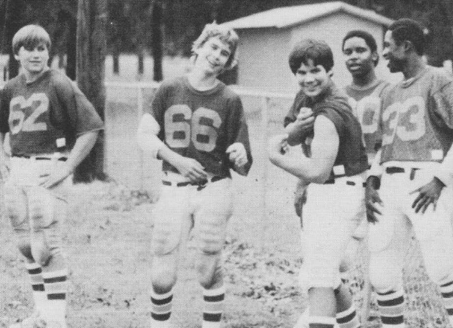 Brett Ligon was an eighth-grader at Montgomery Junior High in the early 1980s when he flexed his biceps for the school photographer. In the background, immediately behind Ligon, is Jonathan Green.