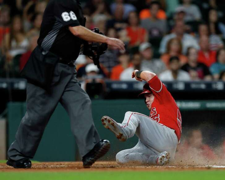Kole Calhoun joins the parade across the plate during a four-run eighth inning as the Angels erased a three-run deficit against the Astros on Saturday night.