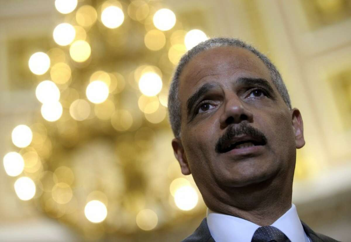 Attorney General Eric holder speaks to reporters following his meeting on Capitol Hill in Washington Tuesday. A Republican-controlled House panel voted Wednesday to cite Holder for contempt of Congress.