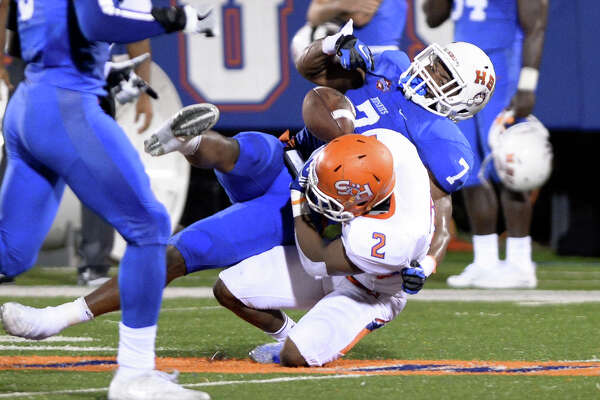 Tyler Scott (2) of Sam Houston State fumbles the ball after making a reception thrown by quarterback Jeremiah Briscoe (16) in the second quarter of a Southland Conference football game between the Houston Baptist University Huskies and the Sam Houston State University Bearkats on September 24, 2016 at Husky Stadium, Houston, TX.