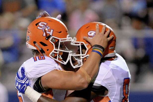 Nathan Stuart (81) of Sam Houston State celebrates with quarterback Jeremiah Briscoe (16) following a touchdown reception in the second quarter of a Southland Conference football game between the Houston Baptist University Huskies and the Sam Houston State University Bearkats on September 24, 2016 at Husky Stadium, Houston, TX.