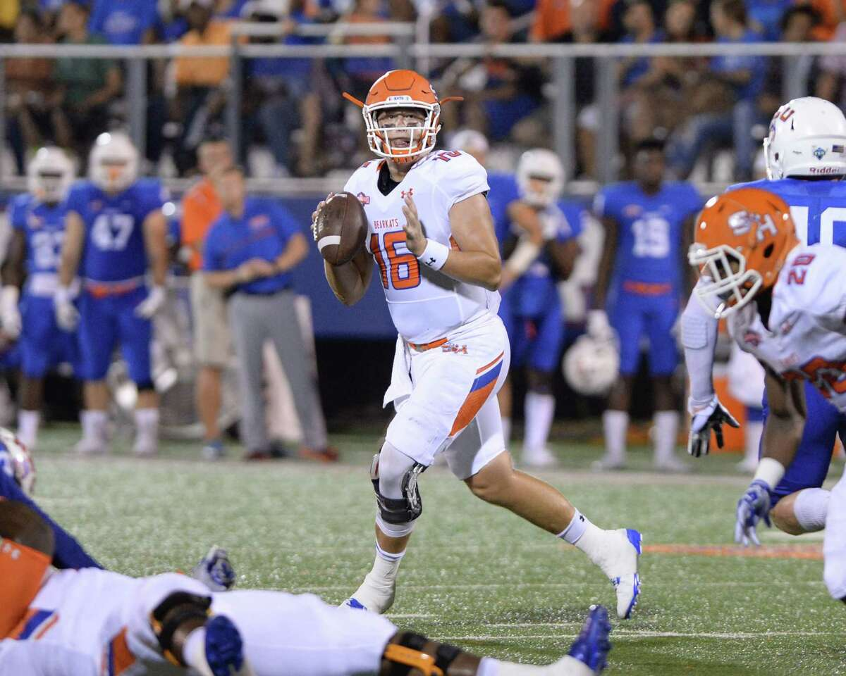 Quarterback Jeremiah Briscoe (20) of Sam Houston State looks for an open receiver in the second quarter of a Southland Conference football game between the Houston Baptist University Huskies and the Sam Houston State University Bearkats on September 24, 2016 at Husky Stadium, Houston, TX.