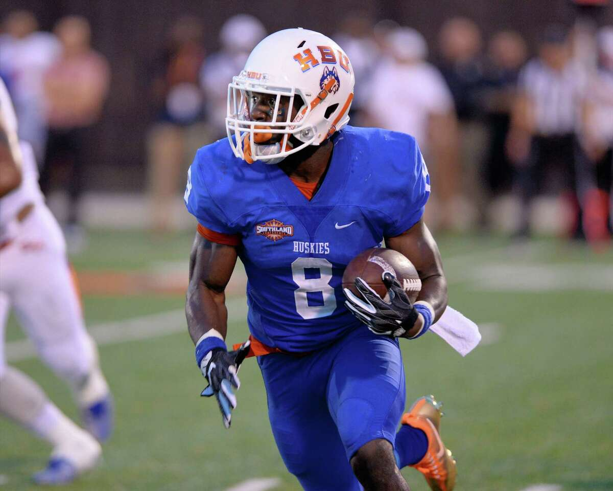 Running Back Terrance Peters (8) carries the ball in the first quarter of a Southland Conference football game between the Houston Baptist University Huskies and the Sam Houston State University Bearkats on September 24, 2016 at Husky Stadium, Houston, TX.