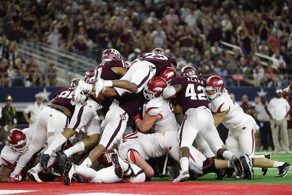 ARLINGTON, TX - SEPTEMBER 24:  The Texas A&M Aggies defense on the goal line against the Arkansas Razorbacks in the third quarter at AT&T Stadium on September 24, 2016 in Arlington, Texas.