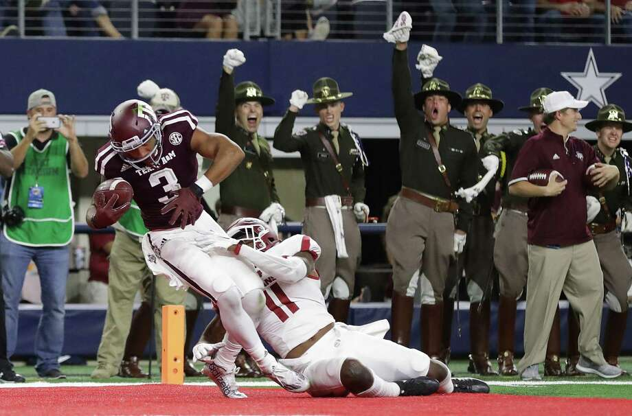 ARLINGTON, TX - SEPTEMBER 24:  Christian Kirk #3 of the Texas A&M Aggies runs for a touchdown against Ryan Pulley #11 of the Arkansas Razorbacksin the fourth quarter at AT&T Stadium on September 24, 2016 in Arlington, Texas. Photo: Ronald Martinez, Getty Images / 2016 Getty Images