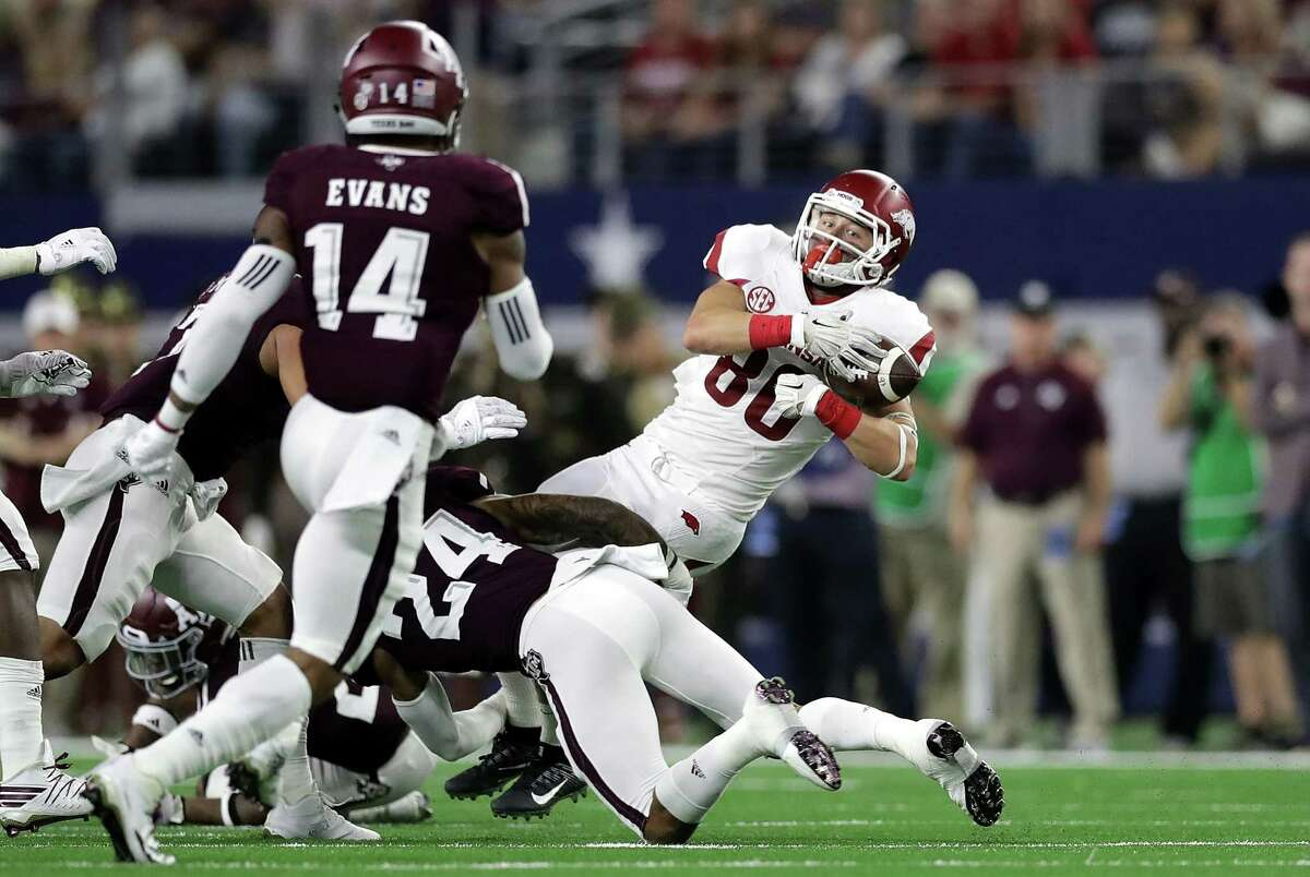 ARLINGTON, TX - SEPTEMBER 24: Drew Morgan #80 of the Arkansas Razorbacks makes a pass reception against Priest Willis #24 of the Texas A&M Aggies in the second quarter at AT&T Stadium on September 24, 2016 in Arlington, Texas.