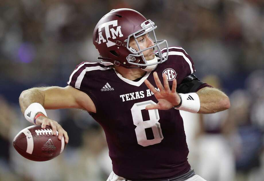 ARLINGTON, TX - SEPTEMBER 24:  Trevor Knight #8 of the Texas A&M Aggies throws the ball for a touchdown against the Arkansas Razorbacks in the third quarter at AT&T Stadium on September 24, 2016 in Arlington, Texas. Photo: Ronald Martinez, Getty Images / 2016 Getty Images