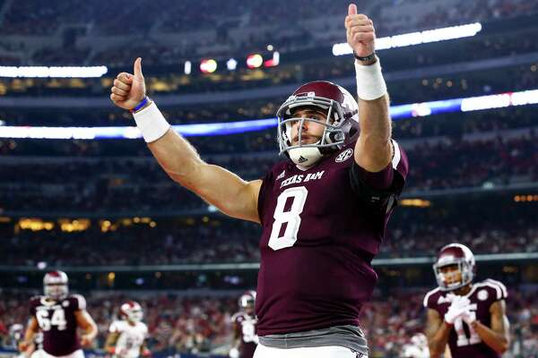 Texas A&M quarterback Trevor Knight (8) celebrates a touchdown against Arkansas in the second quarter at AT&T Stadium in Arlington, Texas, on Saturday, Sept. 24, 2016.